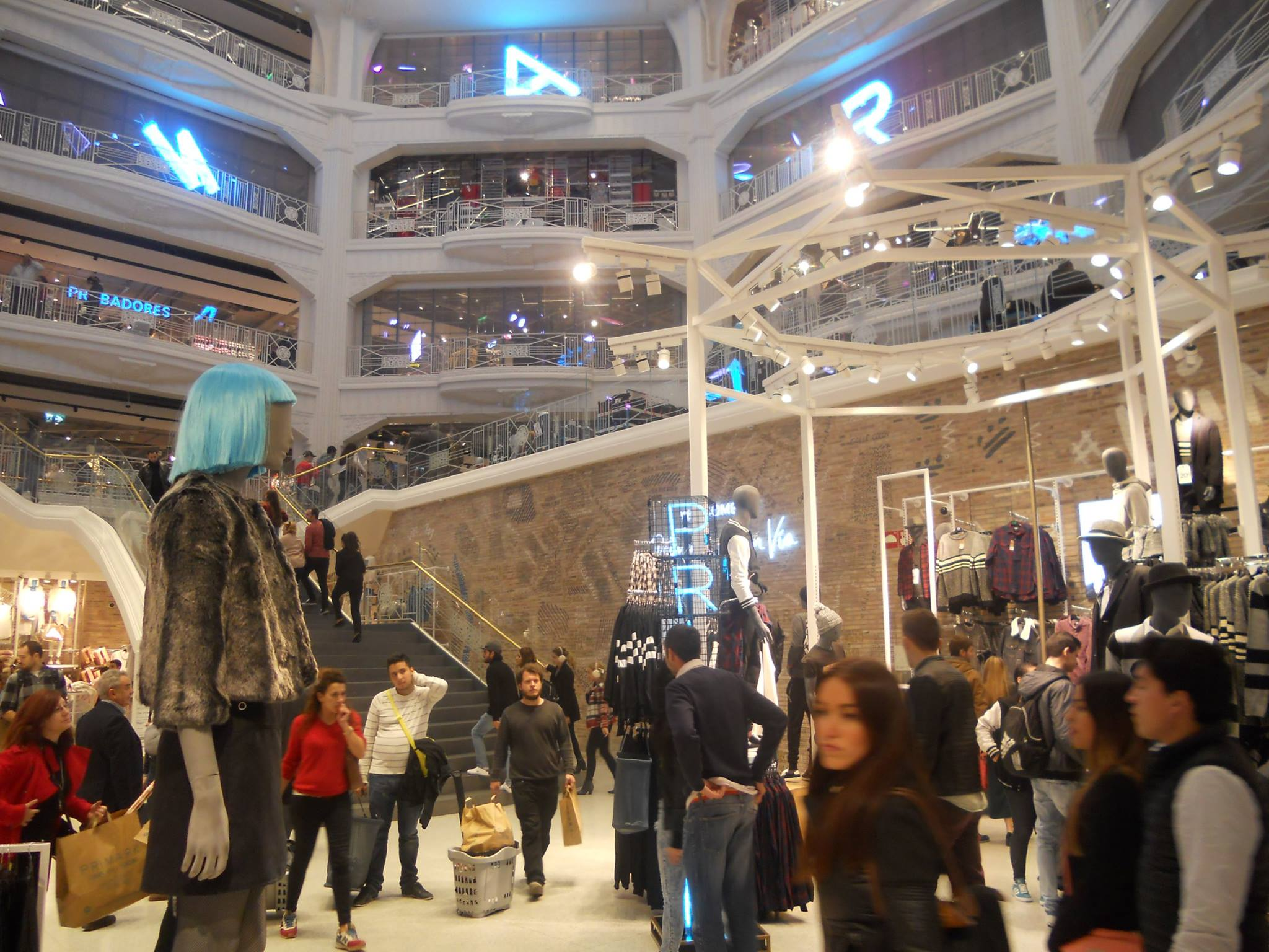 Take a trip down Gran Via in Madrid, and you cannot fail to notice the extraordinary new flagship store from Primark. Follow the Latin crowds of brown paper bag purchasers through the dramatic entrance and catch your breath as you enter the central atrium with its staggering vistas up through the multiple balconies and into the dome of the heavens, the pinnacle of Primark's pre-eminence.